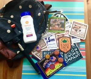 My favorite small backpack, selfie stick, sunscreen, and brew fest swag.